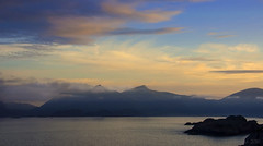 a Northern Goetterdaemmerung (lunaryuna) Tags: sky seascape mountains norway sunrise landscape dawn islands coast lunaryuna cloudscape islets lofotenislands norwegiansea lightmood lofotenarchipelago