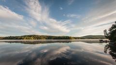 Serenity (tripowski) Tags: morning blue sky usa lake newyork reflection clouds sunrise dawn nikon adirondacks saranac saranaclake 1424 nikond700 1424mm