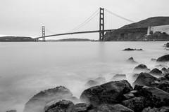 Golden Gate Bridge (BillikenHawkeye) Tags: sanfrancisco longexposure bridge blackandwhite water rocks outdoor goldengatebridge bayarea sanfranciscobay westcoast