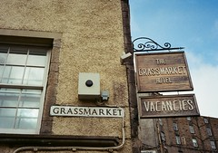 op - grassmarket sign (johnnytakespictures) Tags: street film sign pen writing hotel scotland wooden lomo lomography edinburgh display text olympus font analogue halfframe accommodation grassmarket guesthouse projecting ee3 vacancies lomographycn400