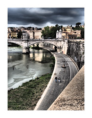 Camminare (Robert-Jan van Lotringen) Tags: city travel italien bridge people italy cloud rome roma reflection history weather architecture clouds buildings river town couple italia walk fiume streetphotography bank tiber tevere rom stpeter