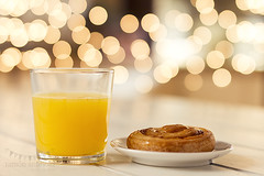 My perfect breakfast: a danish puff pastry swirls and an orange juice (Ramn Antiolo) Tags: christmas xmas light stilllife orange white glass glitter fruit bulb breakfast vintage table spiral wooden healthy shiny energy glow shine bright sweet bokeh juice board traditional puff lifestyle garland illuminated retro danish vegetarian pastry swirl citrus blink bake calories vitamin shabbychic