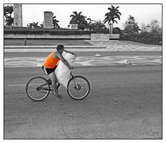 sacked (kurtwolf303) Tags: orange man topf25 bicycle person 500v20f cuba streetphotography santaclara caribbean sack ck fahrrad kuba omd colorkey karibik strase urbanlifeinmetropolis 250v10f lovelycity unlimitedphotos micro43 microfourthirds olympusem5