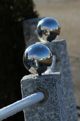 Parallel Worlds (gripspix (OFF)) Tags: test reflection fence ball reflecting steel granite zaun spiegelbild kugel stahl granit irrelevant newlenses spiegelnd 20160212 tamron70300modela17e