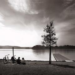 ora merenda (pamo67) Tags: 2 sky bw lake tree water square lago outdoors blackwhite pair calm bn biancoenero coppia dispalle snackpoint shouders pamo67 pasqualemozzillo hoursnack