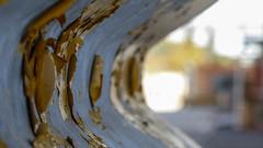 Peeling Crash Paint (Theen ... busy) Tags: park car yellow metal lumix ancient peeling paint factory bokeh land adelaide inside curve mitsubishi reclaimed crashbarrier shallowdof tonsley theen
