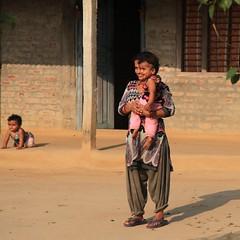 Village Family (Heaven`s Gate (John)) Tags: life door nepal woman sunlight house home girl children village mother chitwan bharatpur johndalkin heavensgatejohn ghatgain