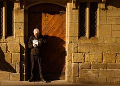 Durham, 2016 (S.R.Murphy) Tags: door winter food sun sunlight man window sunshine durham eating streetphotography chips canon50mmf18 socialdocumentary wintersun sidelight colourstreetphotography canon6d feb2015