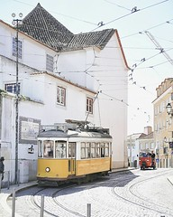 the streets of Lisbon (sma_kee) Tags: street travel urban portugal sunshine lisboa lisbon streetphotography tram sunny journey pastels traveling streetcorner tramway traveler streetshot softtones oldtram softcolors pastelcolors traveljournal yellowtram tramsoflisbon memoriesfromajourney