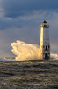Stormlight (Aaron Springer) Tags: lighthouse storm nature landscape outdoor michigan lakemichigan breakingwave frankfort stormlight northernmichigan thegreatlakes portraitorientation novembergale frankfortlighthouse