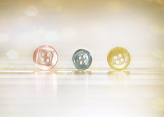 Pastel Buttons (nikagnew) Tags: pink blue macro yellow three soft bokeh buttons circles pastel shapes processing textured subtle