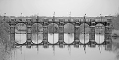 Sluice Reflections at Dutton Locks. Mono (Gerry Hat Trick) Tags: bridge white black reflection water reflections river walking four lumix mono mirror canal cheshire hiking walk arches hike trent valley micro cormorant weaver g3 navigation sluice mersey waterway weir csc thirds m43 mirrorless dmcg3 panasonic45200mmf456ois