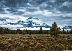 Grand Teton Panoramic #2 (Matt Anderson Photography) Tags: travel usa cloud storm mountains horizontal wisconsin outdoors photography nationalpark purple outdoor dusk scenic lifestyle nopeople panoramic sage illuminated madison vista destination glowing wyoming spirituality grandtetons majestic sunbeam stormcloud scenics lansdscape tetonrange mountainrange tranquilscene colorimage mattanderson mountainpeak beautyinnature otherkeywords mattandersonphotography zzzpics