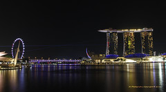 When we cross each other's path -- we light up our life :) (JX76) Tags: lighting singapore colours nightscape ferriswheel marinabay citynightscape ilight colourfuldisplay singaporeflyer marinabaysands canoneos700d artsciencemuseum