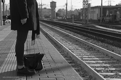 Departure (elenamalossini) Tags: travel blackandwhite bw italy woman white black milan monochrome train freedom nikon memories destination binary bags departure