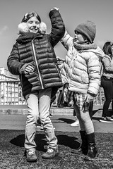 Kids dancing in the cold (Franois Escriva) Tags: people bw white paris france cold kids children photo dance noir dancing candid streetphotography olympus nb rue blanc omd strret