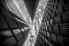 Yes! (Luke Hanna) Tags: sky white black building london monochrome architecture clouds plane y riverside more overhead