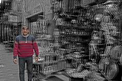 Where Happiness Lives (Velvet Heaven) Tags: red white man black guy smile standing happy stand market egypt happiness things cairo khan effect seller confident flee vibration passionate vibrating khalili