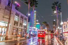 Red Car Trolleys Coming Down the Street (Samantha Decker) Tags: california ca disneyland wideangle anaheim themepark nightrain disneyscaliforniaadventure uwa buenavistastreet canonef1635mmf28liiusm canoneos6d redcartrolley samanthadecker socal16