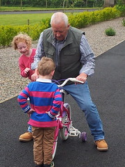 Mechanic's Assessment (mdavidford) Tags: pink bicycle pose ride small blocked stare stabilisers