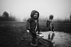 The Hard Way (Kapuschinsky) Tags: winter blackandwhite fall ice monochrome childhood fog fun outside outdoors funny moody child play candid sony lifestyle naturallight slide slip amusing icy slippery emotive kidswillbekids sonya700 sonyphotographing