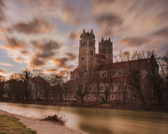 Sunset In Munich (theAtanas) Tags: world city longexposure travel winter sunset sea building church nature water colors field skyline architecture night river germany munich mnchen landscape flow bayern deutschland bavaria evening europe long exposure outdoor kirche monaco burning around serene fluss isar allemagne depth hdr maximilian everning   sakristei    bestofoutdoor