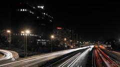 M30 (Sirona Fotografía) Tags: puente edificios publicidad nocturna carteles farolas coches curva m30 luminosos estelas blancoynegroparcial