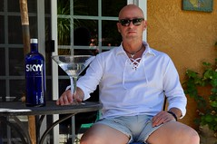 All Things Big (Blue Rave) Tags: bulge 2016 bloke dude guy male mate people legs thighs shorts meninshorts guysinshorts vodka alcohol martini drink drinking sunglasses rayban cool skyy thecolorblue blue color colors colour colours sitting patio wayfarer bigmartiniglass bigmartini