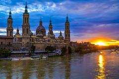 Atardece en el Ebro (.MiguelPU) Tags: bridge sky espaa sol water rio pilar river puente spain agua colours catedral colores zaragoza cielo nubes ebro amarilla