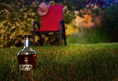 Jura Superstition (golecwoj) Tags: colors bottle chair whiskey jura scotch cowboyhat superstition