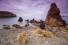 Bad Stone Beach II. (dasanes77) Tags: longexposure cliff seascape beach nature sunrise reflections landscape dawn sand rocks peace shadows purple tripod shoreline calm murcia ping cloudscape mazarrn canonef1635mmf4lisusm canoneos6d badstone