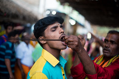 Devotee (Karthikeyan.chinna) Tags: travel portrait people india festival canon temple south feather devotion 5d tradition devotee tamilnadu karthikeyan cwc chinna markiii kaveripattinam chennaiweekendclickers chinnathamby