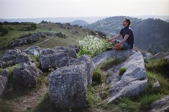 """ Breathing deeper than I've ever breathed before ..."" (mrkkraxner) Tags: light sunset portrait sun mountain man flower green film nature grass 50mm hungary peace bright path air breath gray rocky hills blessing valley meditation chill wandering chinon budars ektar"