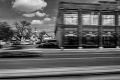StPaulArtCrawl2016_46290-.jpg (Mully410 * Images) Tags: street trees blackandwhite motion building monochrome car clouds stpaul 2016 artcrawl niksilverefexpro