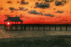 "trespass (listening to ""just couldn't tie me down"", the black keys) (jeneksmith) Tags: sunset red sky orange sun seascape beach nature yellow clouds canon mississippi coast pier sand natural outdoor coastal shore waterscape passchristian mississippisound bayofstlouis hendersonpoint canoneos70d"