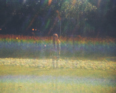 """I really can't stand to see you so depressed."" (H o l l y.) Tags: light portrait color film water girl grass sunshine analog forest vintage river lens rainbow lomography experimental kodak 110 retro indie holographic trimlite"