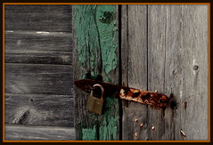 Rusty Door Latch (Judy Gayle) Tags: wood green rust nails latch peeledpaint