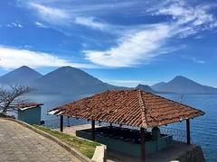 Lake Atitln ((Jessica)) Tags: travel lake water lago volcano guatemala sunny atitln atitlan volcanoes pw pila iphone tileroof volcn