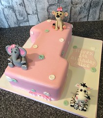 Pink number 1 birthday cake with baby animals