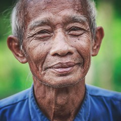 I know you gonna like his smile...instagram:@pandevonium_images Bali Portrait Bali, Indonesia Balinese Traveling Travel Travel Photography Headshot Oldman Smile Happy Positive Vivid Green Faces Of EyeEm Face Character Travelling Portraits Portrait Of A Ma (Nick Pandev) Tags: travel portrait bali travelling green smile face portraits canon indonesia happy character vivid oldman headshot positive traveling manfrotto balinese lowepro travelphotography portraitofaman baliphotography facesofeyeem