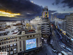 Gran Via Sunset (Alesfra) Tags: madrid life street city longexposure blue light sunset sky urban españa orange sun sunlight cold building luz sol window car azul skyline architecture composition advertising ventana hotel photo calle promo spain arquitectura foto publicidad view dusk balcony capital edificio ciudad paisaje olympus capitol coche cielo vista urbana vodafone balcon frio anochecer omd cartel urbanscape schweppes landascape em1 naranaja sinespejo mirrorless 6stop alesfra albertojespiñeirafrancés alesfraphotography alesfrafotografia wwwalesfracom olympusem1 olympusomdem1 leefilter09ndsoftgrad mzuiko918mmf456edmsc haidandfilter18nd64x