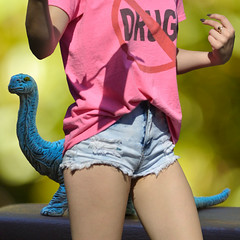 Messages (swong95765) Tags: sexy female message dinosaur bokeh body tshirt drugs shorts distraction advertize