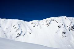 Pourtant que la montagne est belle (Laurent VALENCIA) Tags: snow ski france alps building sports montagne alpes canon buildings woods ciel surfers neige foule savoie laplagne matin pistes skieurs frenchalps randonne immeubles sapins glisse