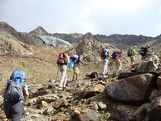 Group climbing mountains on rocky terrain