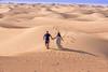 DSC03329 (cihanaksoy25) Tags: desert uae running abudhabi mirage footsteps runningaway
