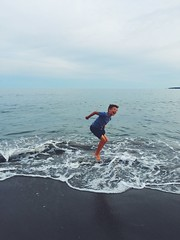 Happy (leothedarling) Tags: light boy summer beach smile happy jump day waves massachusetts joy newengland happiness glad laugh