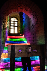Rainbow stairs. (Complete Buffoon) Tags: lighting longexposure light woman castle window girl stairs painting newcastle steps stocks torch pillory shedoesntlookhappy