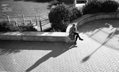 Time to Rest (4foot2) Tags: street leica shadow people blackandwhite bw film girl monochrome 35mm mono seaside sitting shadows kodak trix streetphotography summicron 35mmfilm promenade diafine kodaktrix rest streetphoto resting analogue lookingdown m3 peoplewatching reportage streetshot reportagephotography sitdown 2016 filmphotography 35mmf2 interestingpeople leicam3 1200iso 1200asa peopleofbrighton 35mmf2summicron 4foot2 4foot2flickr 4foot2photostream fourfoottwo
