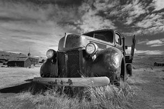 Old pickup truck (madrones) Tags: california ca travel sky blackandwhite bw usa cloud abandoned broken car weather northerncalifornia clouds truck automobile afternoon unitedstatesofamerica sunny pickup historic northamerica ghosttown historical bodie sierranevada dramaticsky deserted goldrush stationary rustycar rustytruck abandonedcar easternsierra goldmining nationalhistoriclandmark monocounty bodiestatehistoricpark arresteddecay notfunctional