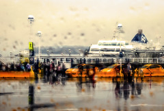 Arrival (N Medd) Tags: ocean travel sea vacation people blur rain yellow ferry vancouver marina bay pier waiting day ship taxi victoria terminal rainy impressionism passenger arrival traveling departure swartz photoimpressionism
